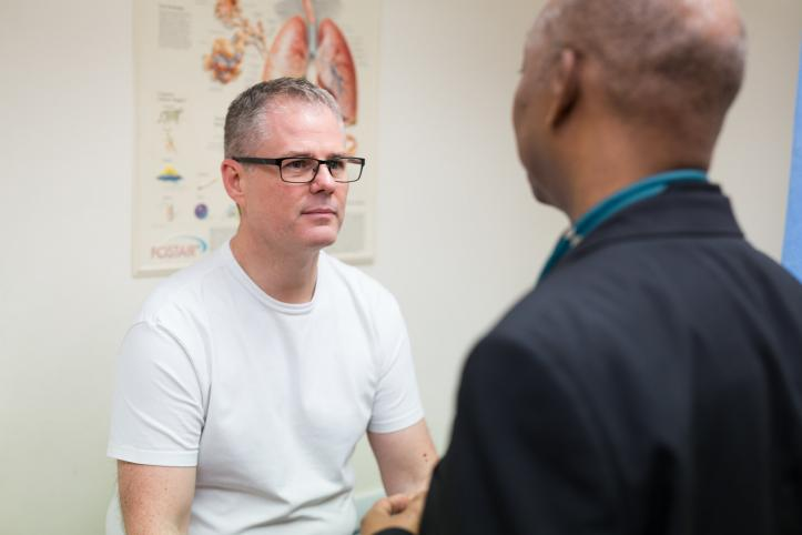 Patient talking with a professional in a doctors room